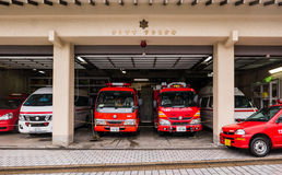 Fire trucks. Miyajima, Japan - May 6, 2016: Fire trucks on Miyajima island. Miyajima island is a famous island shrine-town is a UNESCO World Heritage Site and a Stock Photo