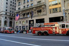 Fire trucks parked on Fifth Avenue,NYC,2015. People gathered outside storefront, with fire trucks parked near sidewalks, answering call on Fifth Avenue, NYC,2015 Stock Image