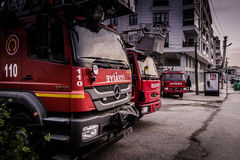Fire Trucks Parked On Roadside. Fire trucks parked on the roadside in Cinarcik town with a gas station on the background. The district of Yalova city is a Stock Photos
