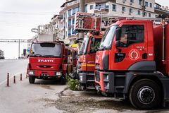 Fire Trucks Parked On Roadside. Fire trucks parked on the roadside in Cinarcik town with a gas station on the background. The district of Yalova city is a Royalty Free Stock Photos