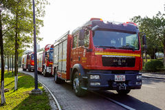 Fire trucks parked on the sidewalk. Stock Photo