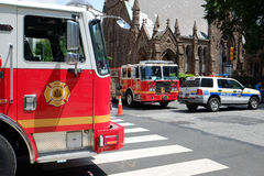 Fire trucks and police block off access to the col Royalty Free Stock Image