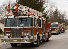 Fire trucks on scene. Three firetrucks on the scene in a residential area Stock Photo