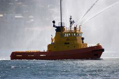Fire Tug. With water spraying Stock Image