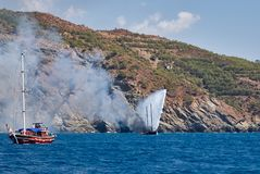 Fire on Turkish yacht in the Mediterranean Sea. Another yacht and Fire extinguishing helicopter Kamov Ka-32 came to the rescue. Ol stock images