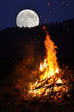 Fire under moonlight Stock Photos