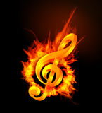 Fire violin key sign. On black background Royalty Free Stock Photos