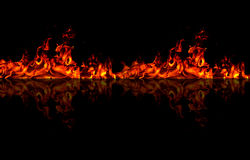 FIre wall. Isolated flames on black background with reflection Stock Images