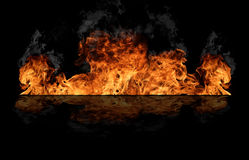 Fire wall. Fire flames isolated on black background Royalty Free Stock Images