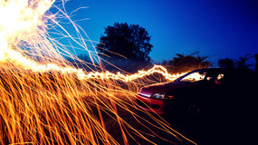Fire wall behind red sports car Stock Images