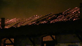 A fire in a warehouse at night stock footage
