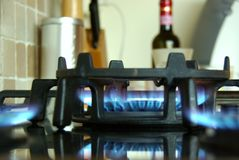 Fire, warmth and wine in homey kitchen Stock Image