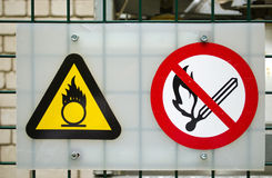 Fire warning signs compressed oxygen gas cylinders. Fire warning signs near compressed oxygen gas cylinders stock photos