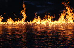 Fire and water. Fire flames and reflection in water. A breathtaking shot of fire on water. The waterworld show at Universal Studios Hollywod ended with a stock photo