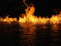Fire and water. Fire flames and reflection in water Royalty Free Stock Photography
