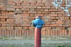 Fire water hydrant. Big water pump on street, grunge Stock Photography