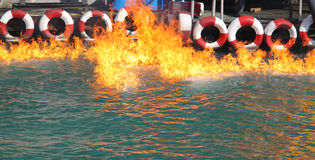 Fire on water near boat station Stock Photography