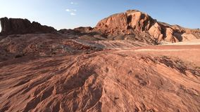 Fire Wave Hike. Stripes in red rock along Fire Wave Hike at Valley of Fire State Park at sunset in Nevada, United States. Colorful lines in Mojave desert stock video