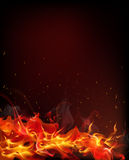 Fire. Which spread from the tongues of flame from which soar into the air and heat scorched particles on a black background Royalty Free Stock Photography