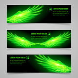 Fire wings. Set of mystic banners with green flaming wings Stock Images