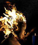 Fire Woman. This is a composite of photography and a 3D rendering. A tragic love story between a fire woman and a candle Stock Photos