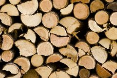Fire wood. End view of pile of fire wood logs stock image