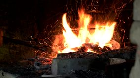 Fire wood burning in furnace. Blacksmith heating metal in furnace at workshop. Preparation for forging stock video