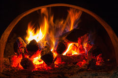 Fire wood burning in the furnace. Wood-burning stove designed to heat your home royalty free stock photography