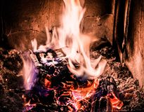 Fire and wood burning in old stove with embers Royalty Free Stock Photography