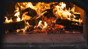 Fire in a wood burning oven Stock Photo