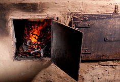 Fire in a wood burning stove royalty free stock images