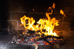 Fire wood burns in a fireplace Royalty Free Stock Images