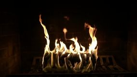 Fire wood flame burning in cosy lovely log atmosphere fireplace in satisfying majestic close up slow motion shot of