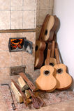 Fire wood, guitar. Fire wood, a guitar workshop, signature stamps, guitars, a guitar, the master, a workshop, 6 string guitar, the russian furnace Royalty Free Stock Photography