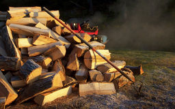 Fire Wood, Log Splitter, Rake. A picture of first frost in fall.  Time to finish getting the firewood ready Stock Images