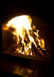 Fire in wood oven Stock Photography
