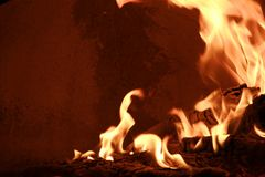 Fire on a wood oven. Fire ready for baking in a rustic wood bread and pizza oven Stock Photos