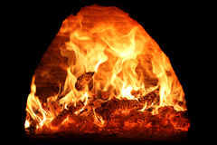 Fire with the wood in the oven Stock Images