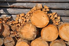 Fire wood at a shed wall Royalty Free Stock Photography