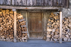 Fire Wood Stacked Outside Barn Door Stock Photography