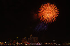 Fire work display in the city Royalty Free Stock Image