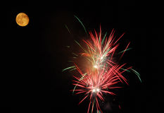 Fire works and moon Royalty Free Stock Image