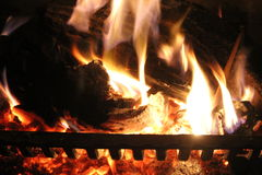Fire. Yellow flames wood burning logs Royalty Free Stock Image