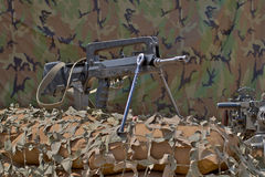 Firearm FAMAS. On a background of camouflage tent Stock Image
