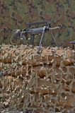 Firearm FAMAS. On a background of camouflage tent Stock Photography