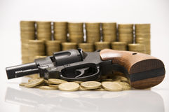Firearm and gold Royalty Free Stock Image