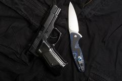 Firearm and knife. Weapons and men`s clothing. Top royalty free stock image