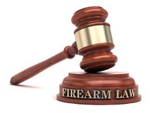 Firearm law. Gavel and Firearm text on sound block stock photos