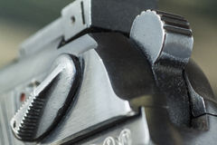 Firearm Pistol  on military camouflage background Royalty Free Stock Images