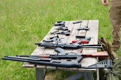 Firearm on the table outdoors Royalty Free Stock Images